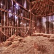 Stock Photo: Interior of old barn with straw bales