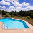 Backyard swimming pool and patio - Stock Photo