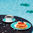 Breakfast by the pool on sunny day — Stock Photo #6214200