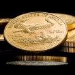 Macro image of gold eagle coin on stack — Stock Photo