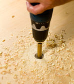 Woodwork tools working on piece of plywood — Stock Photo
