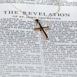 Antique gold cross on page of bible — Stock Photo