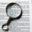 Antique brass magnifying glass - Stock Photo