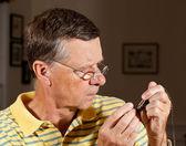 Senior repairing pocket watch — Stock Photo