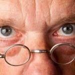 Senior man with focus on glasses — Stock Photo
