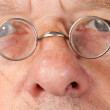 Senior man with focus on glasses — Stock Photo #6312910