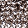 Ball bearings illuminated by white lights — Stockfoto