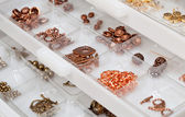 Drawers of jewelery findings — Stock Photo