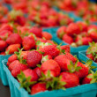 Containers of strawberries at a farmers market - Stock Photo