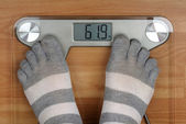 Feet on the scales — Stock Photo