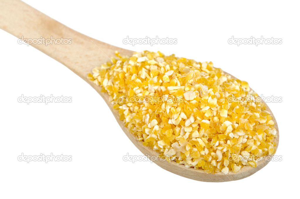 Corn grits on wooden spoon, isolated on a white background — Stock Photo #6456770