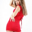 Beautiful pretty woman posing in red dress. — Stock Photo #5885591