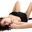 Beautiful young woman is covered with black cloth lie on the white floor. — Stock Photo #6451426