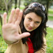 Pretty girl showing Stop! gesture with her hand. — Stock Photo