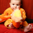 Cute baby boy toddler sitting and holding slippers in hand. — Stock Photo #6452314