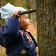 A little boy with a stick in his hand. - Stock Photo