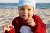 Bright portrait of adorable baby in the sweater. — Stock Photo