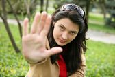 "Pretty girl showing ""Stop!"" gesture with her hand. — Stock Photo"