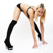 Young woman in black panties, bra and shoes. — Stock Photo