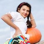 Beautiful woman with pumpkin. — Stock Photo #6470328