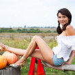 Beautiful woman with pumpkin. — Stock Photo #6470342