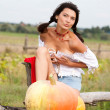 Beautiful woman with pumpkin. — Stock fotografie #6470382