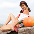Beautiful woman with pumpkin. — Stockfoto #6470521