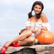 Beautiful woman with pumpkin. — Foto de stock #6470558