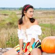 Beautiful woman with pumpkin. — ストック写真 #6470576