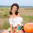 Stock Photo: Beautiful woman with pumpkin.