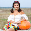 Beautiful woman with pumpkin. — Stockfoto #6470641