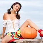 Beautiful woman with pumpkin. — Stock Photo #6470650