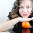Woman with orange — Stock Photo