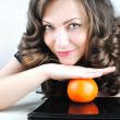 Woman with orange — Stock Photo #5546035