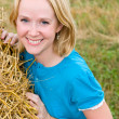 Young woman in a field — Stock Photo #5416396