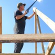 Royalty-Free Stock Photo: Builder at roofing works