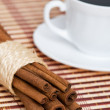 Cinnamon and cup of coffee — Stock Photo