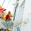 builder facade painter at work — Stock Photo #5417659