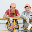Happy builder facade painters - Stock Photo