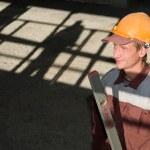 Постер, плакат: Worker builder with level