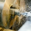 Drilling hole in blank on turning machine — Stock Photo #5417889