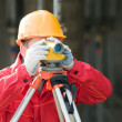 Surveor at work with level — Stock Photo #5418153