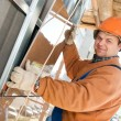 Worker builder at facade tile installation - Stock Photo