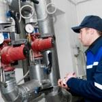 Heating engineer in boiler room — Stock Photo #5418858