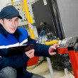 Heating engineer in boiler room — Stock Photo #5418867