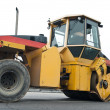 Compactor at asphalt pavement works — Stock Photo #5419228