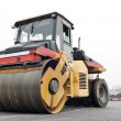 Compactor at asphalt pavement works - ストック写真