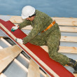 Stockfoto: Worker at roofing works