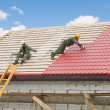Foto de Stock  : Roofing work with metal tile