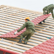 Roofing work with metal tile — Stock fotografie #5419348
